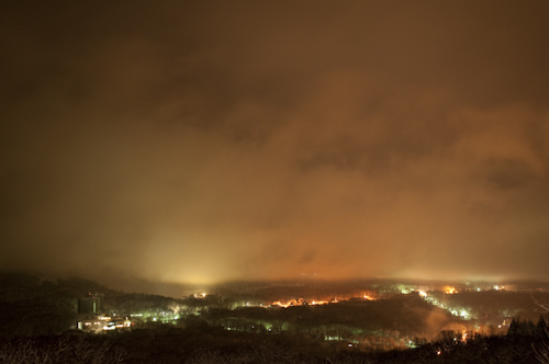 The lights of Niseko illuminate the low lying clouds and fog that typically roll in during the nights