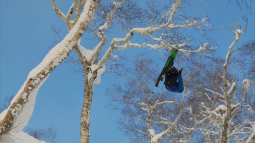 Eben Mond Tapping Branches on His Second Backflip Rotation